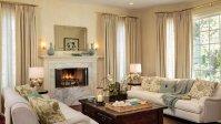 The living room's large windows, cream-and-aqua color ...