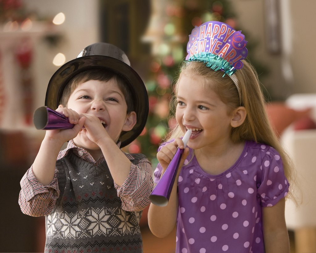 Two small children celebrate New Years Eve together