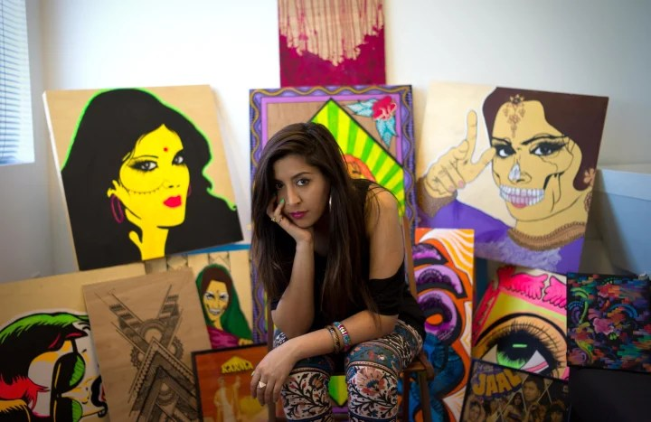 Nisha with her work at her studio in Emeryville, Calif.