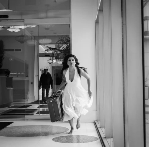 """Minita Gandhi carries her father's suitcase in her one-woman show, """"MUTHALAND."""""""