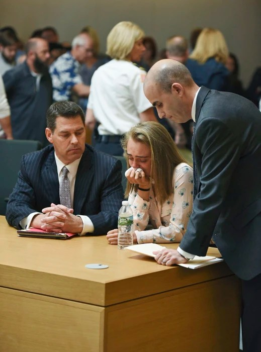 Image: Michelle Carter cries while flanked by defense attorneys Joseph Cataldo, left, and Cory Madera