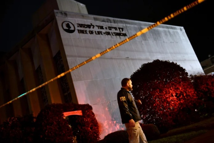 An FBI agent outside of the Tree of Life Synagogue, where 11 people were killed by a gunman, in Pittsburgh on Oct. 27, 2018.