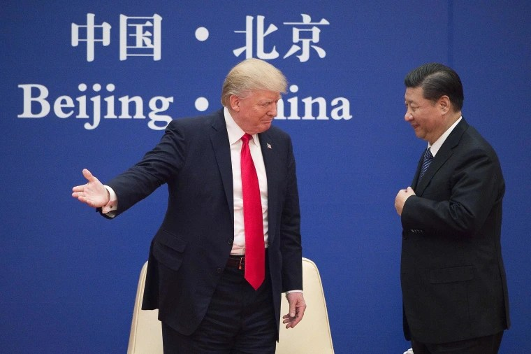 Image: President Donald Trump greets China's President Xi Jinping during a business leaders event at the Great Hall of the People in Beijing