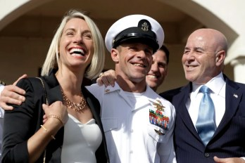 Image: Navy Special Operations Chief Edward Gallagher with his wife, Andrea, and adviser, Bernard Kerik, as they leave military court in San Diego on July 2, 2019.