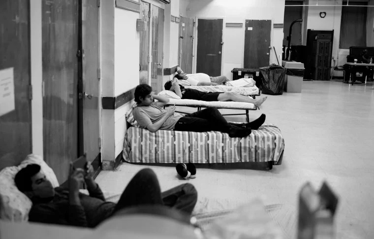 Image: Guest lay in beds provided at the shelter.
