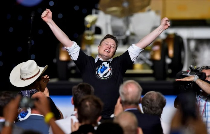 SpaceX CEO and owner Elon Musk celebrates after the launch of a SpaceX Falcon 9 rocket and Crew Dragon spacecraft on NASA's SpaceX Demo-2 mission to the International Space Station from NASA's Kennedy Space Center in Cape Canaveral