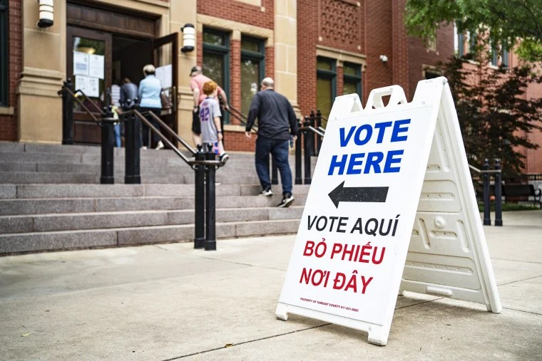 People walk into Southlake Town Hall to vote in municipal elections in Southlake, Texas, on May 1, 2021.