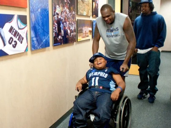 Make-A-Wish recipient Charvis Brewer and his older brother, Nicholas, get a behind-the-scenes tour from Memphis Grizzlies basketball player Zach Randolph.