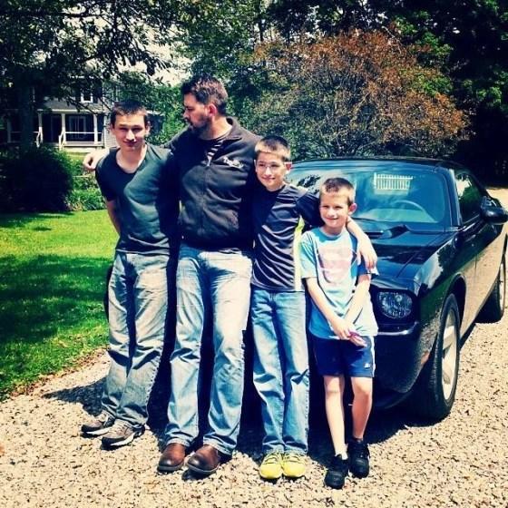 Ron Mattocks and his three sons.