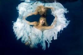 Image ID: ibxaaa02247354.jpg Underwater model presenting fashion in pool, Odessa, Ukraine, Eastern Europe