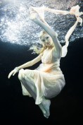 Image ID: PUR0076881 Young woman underwater
