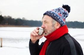 Media Bakery ID: CUL0132762 Man outdoors having hot drink
