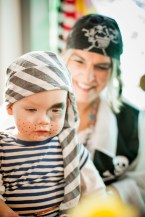 Media Bakery ID: CUL0088889 Mother and son wearing pirate costumes