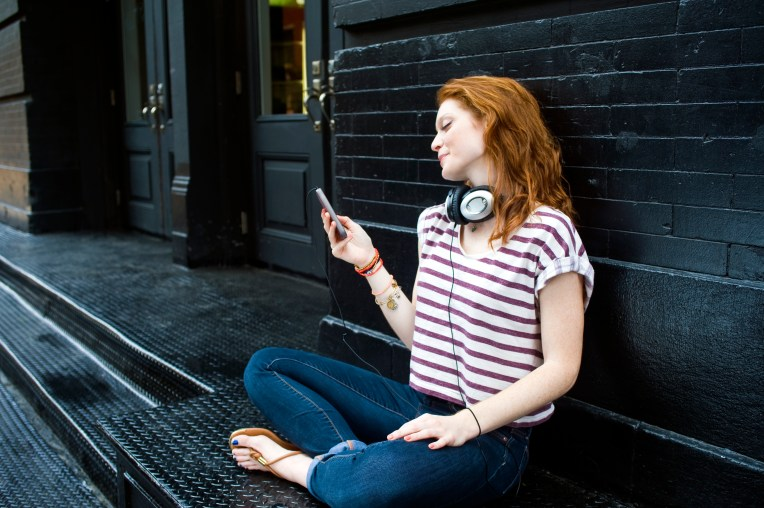 Portrait of young woman using mobile phone