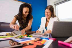 Business women choosing samples --- Image by © Jim Craigmyle/Corbis