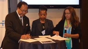Dr. Benjamin F. Chavis, Denise Rolark-Barnes and Martha Montoya.