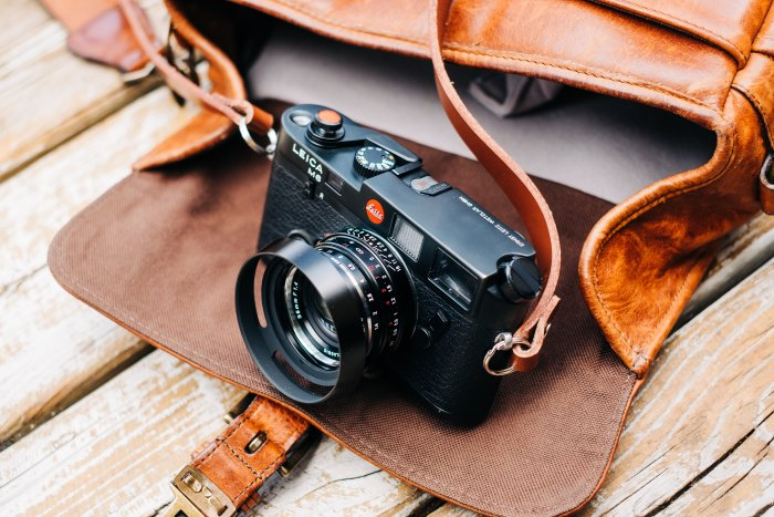 Camera and brown leather camera bag
