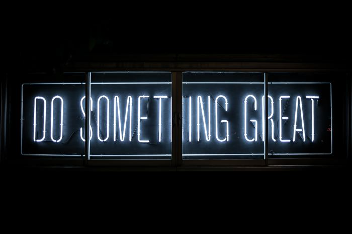 Neon sign that says Do Something Great