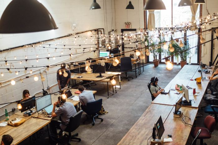 Overhead view of people working in a shared workspace