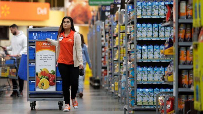 Walmart employee walking through an aisle