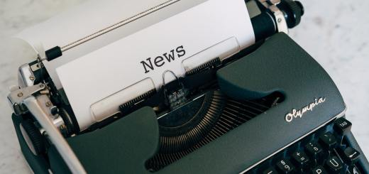 "Image of a typewriter with a sheet of paper with ""news"" typed on it"