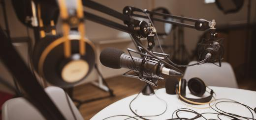 photo of a podcast recording room and equipment