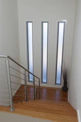 Modern Staircase Window Design | Window Design For Stairs | Exterior | Kitchen Color Combination | Home Wooden Staircase | Residential | Two Story Staircase