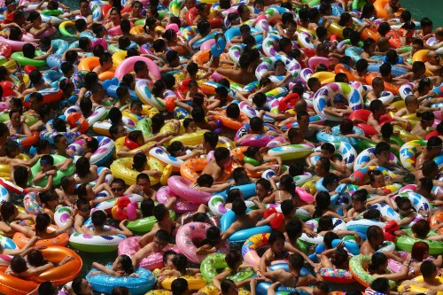Description of . This picture taken on July 25, 2014 shows people cooling off in a water park in Suining, southwest China's Sichuan province. Meteorological departments issued an orange alert for high temperature as a heat wave embraces Sichuan province, with temperature of most area topped 37 , local media reported. CHINA OUT   AFP PHOTOSTR/AFP/Getty Images