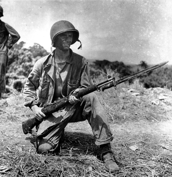 Description of  Jan. 26, 1943: An infantryman is on guard on Grassy Knoll in Guadalcanal, Solomon Islands during World War II.  (AP Photo)