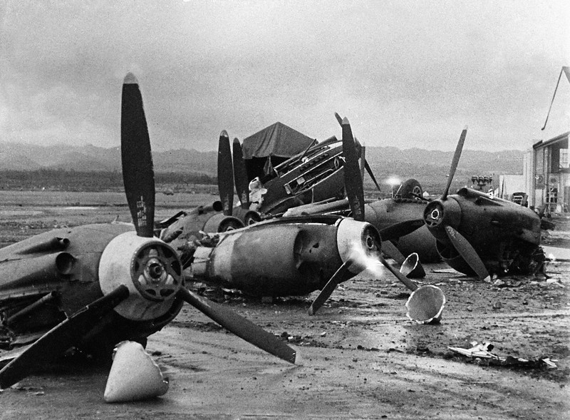 Description of  The shattered wreckage of American planes bombed by the Japanese in their attack on Pearl Harbor is strewn on Hickam Field, Dec. 7, 1941. (AP Photo)
