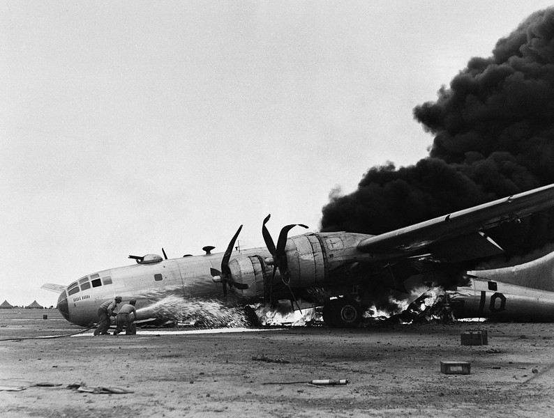 Description of  July 9, 1945: A B-29 burns furiously after an emergency landing on Iwo Jima, Japan while returning from a raid on the Japanese Mainland. Army Air Forces caption says the plane was badly shot up on the raid but the fire resulted from damage to hydraulic systems which caused a locked brake and a crash upon landing. (AP Photo)