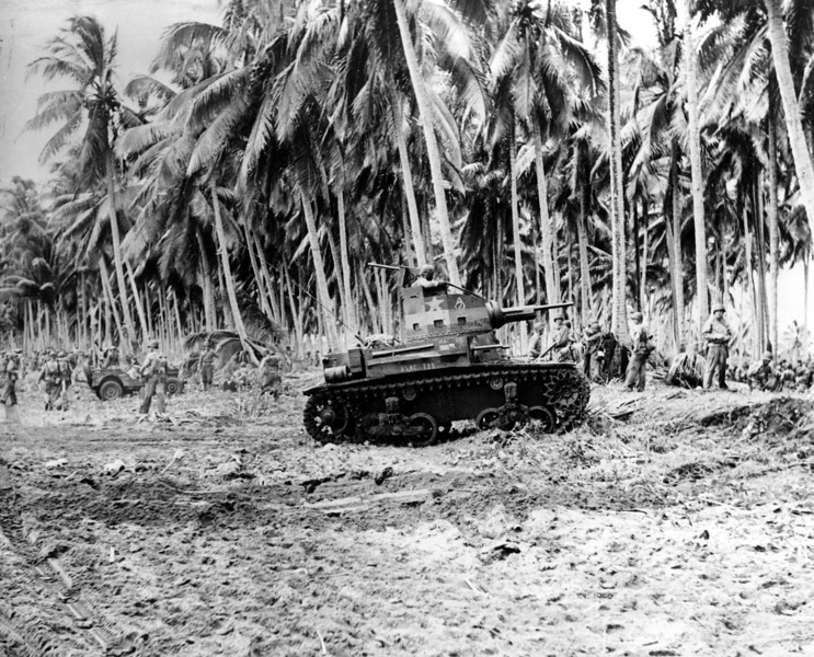 Description of  Aug. 29, 1942: After landing in force, U.S. Marines pause on the beach of Guadalcanal in the Solomon Islands before advancing inland against the Japanese during World War II. (AP Photo)
