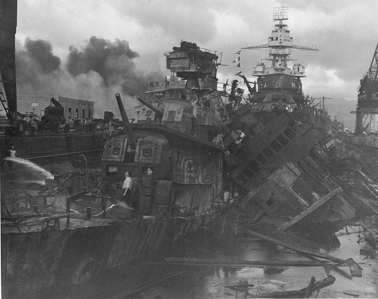 Description of  December 7, 1941: Heavy damage is seen on the battleships U.S.S. Casin and the U.S.S. Downes, stationed at Pearl Harbor after the Japanese attack on the Hawaiian island. (AP Photo/U.S. Navy)