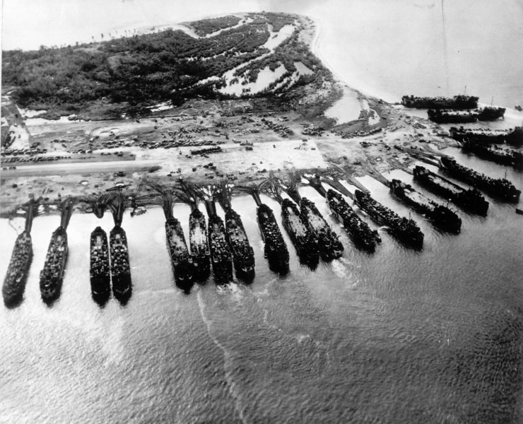 Description of  November 1944: U.S. landing ship tanks are seen from above as they pour military equipment onto the shores of Leyte island, to support invading forces in the Philippines. (AP Photo)