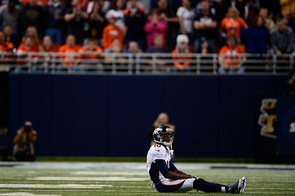 Description of . Wide receiver Emmanuel Sanders #10 of the Denver Broncos sits in disbelief after he can't hold on to the ball on a 4th down pass as the broncos turn the ball over on downs  vs the St. Louis Rams in the Edward Jones Dome November 16, 2014 St. Louis, MO (Photo By Joe Amon/The Denver Post)