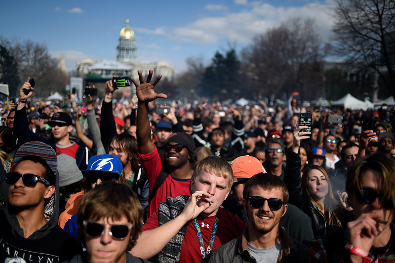 DENVER, CO - APRIL 19: Fans of marijuana and hip hop artist Rick Ross cheer as the clock hits 4:20 p.m. during Denver's annual 4/20 festival at Civic Center Park on Sunday, April 19, 2015. Thousands of people gathered to watch a free Rick Ross concert, while partaking in the day's goods and services. (Photo by AAron Ontiveroz/The Denver Post)