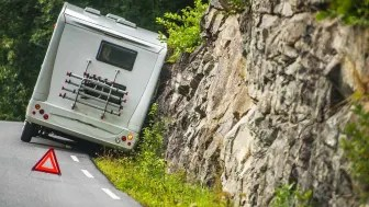 A disabled RV off the side of a road