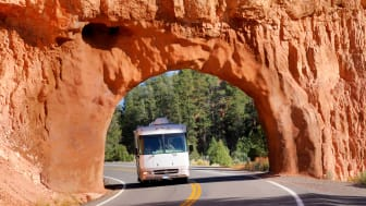 Motor Home Coming Through Red Arch On Highway in Bryce Canyon National Park