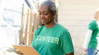 Senior volunteer holding a clipboard