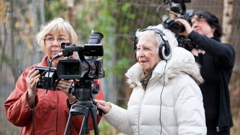 Two older participants filming