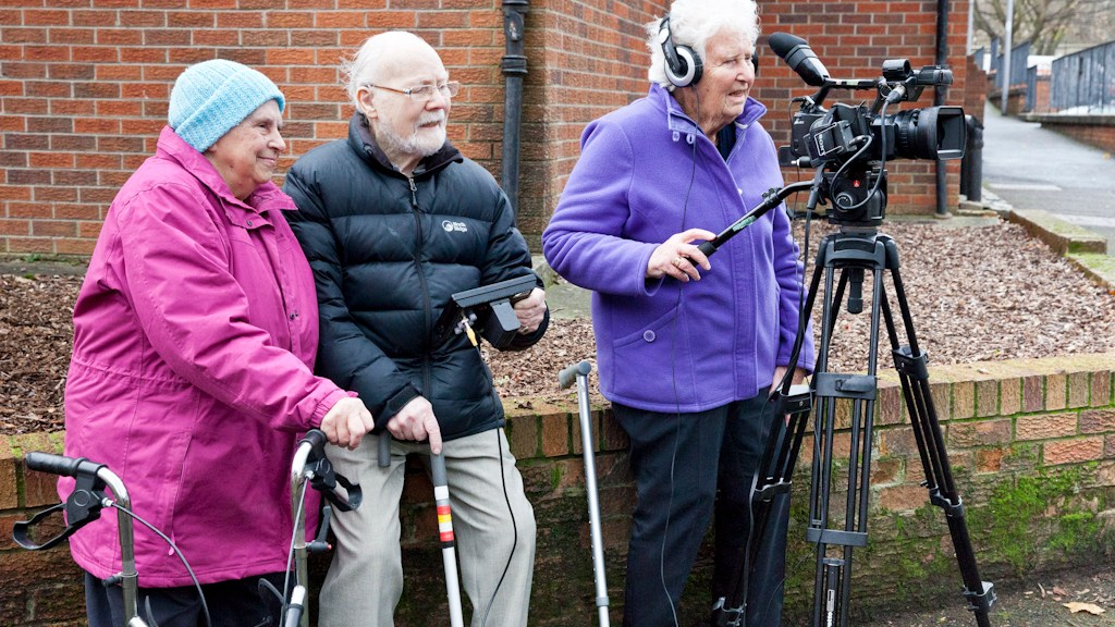 Three older participants filming