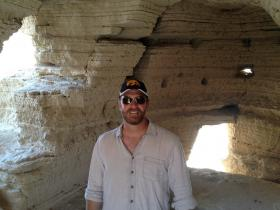 Dr. Robert Cargill in Qumran Cave 4. Photo by Yuval Peleg.