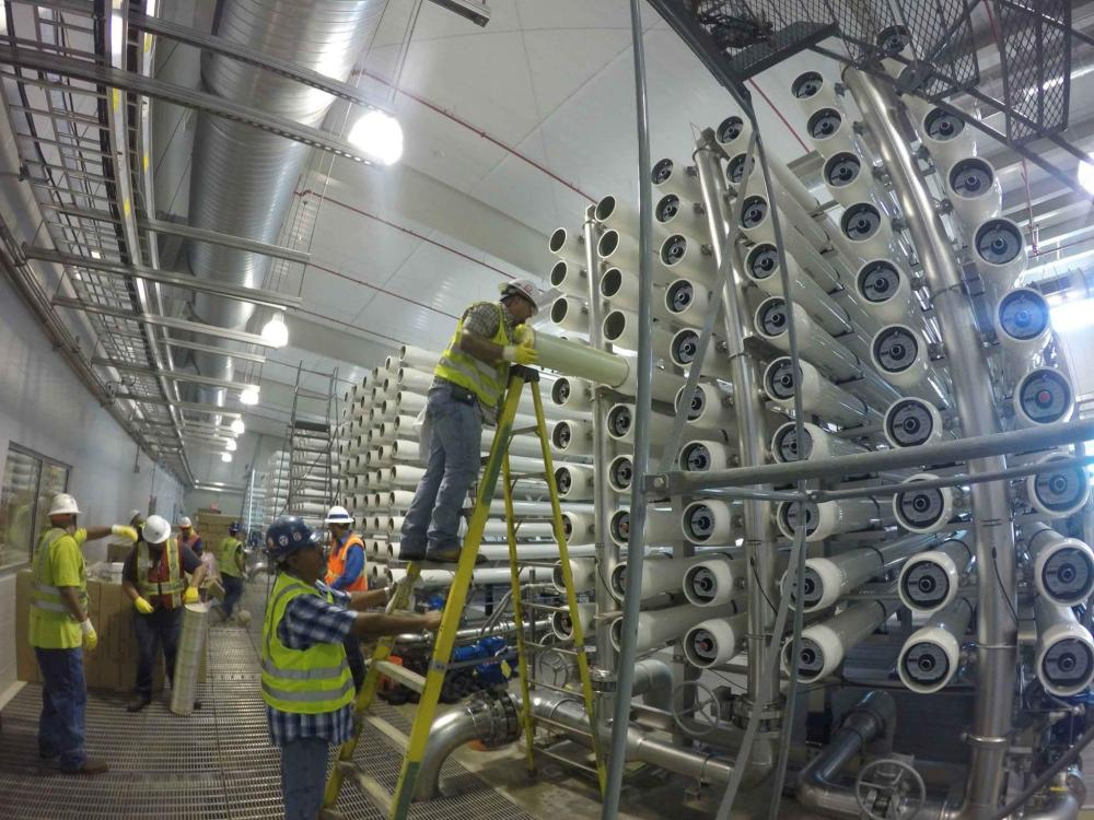 medium resolution of workers install filters at a saws desalination facility in south bexar county