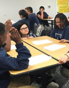 At excel public charter school in kent academic intervention specialist mona swanson works with students  science class also why more black attend schools wa kuow news and rh archive