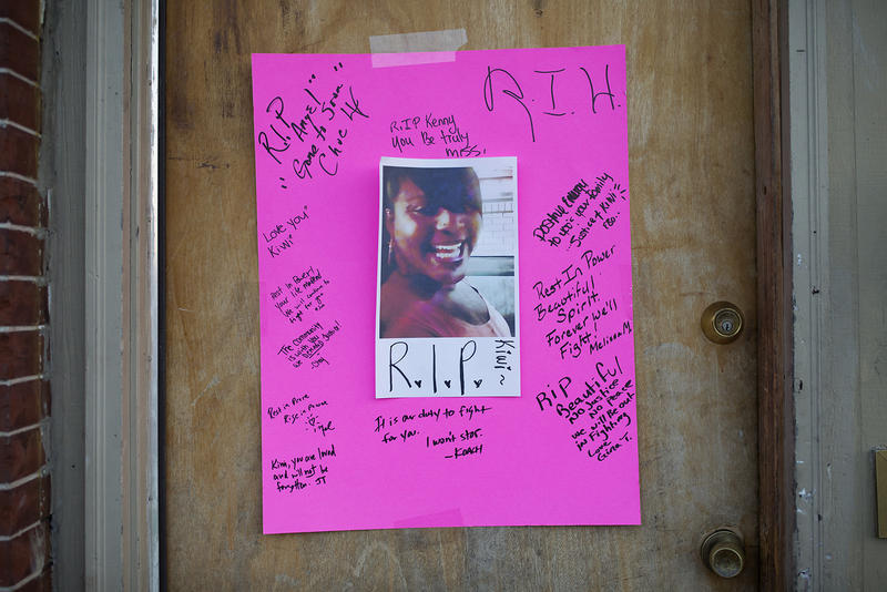 This pink poster with a photo and scribbled rememberances was hung on the door to the apartment building where Kenneth