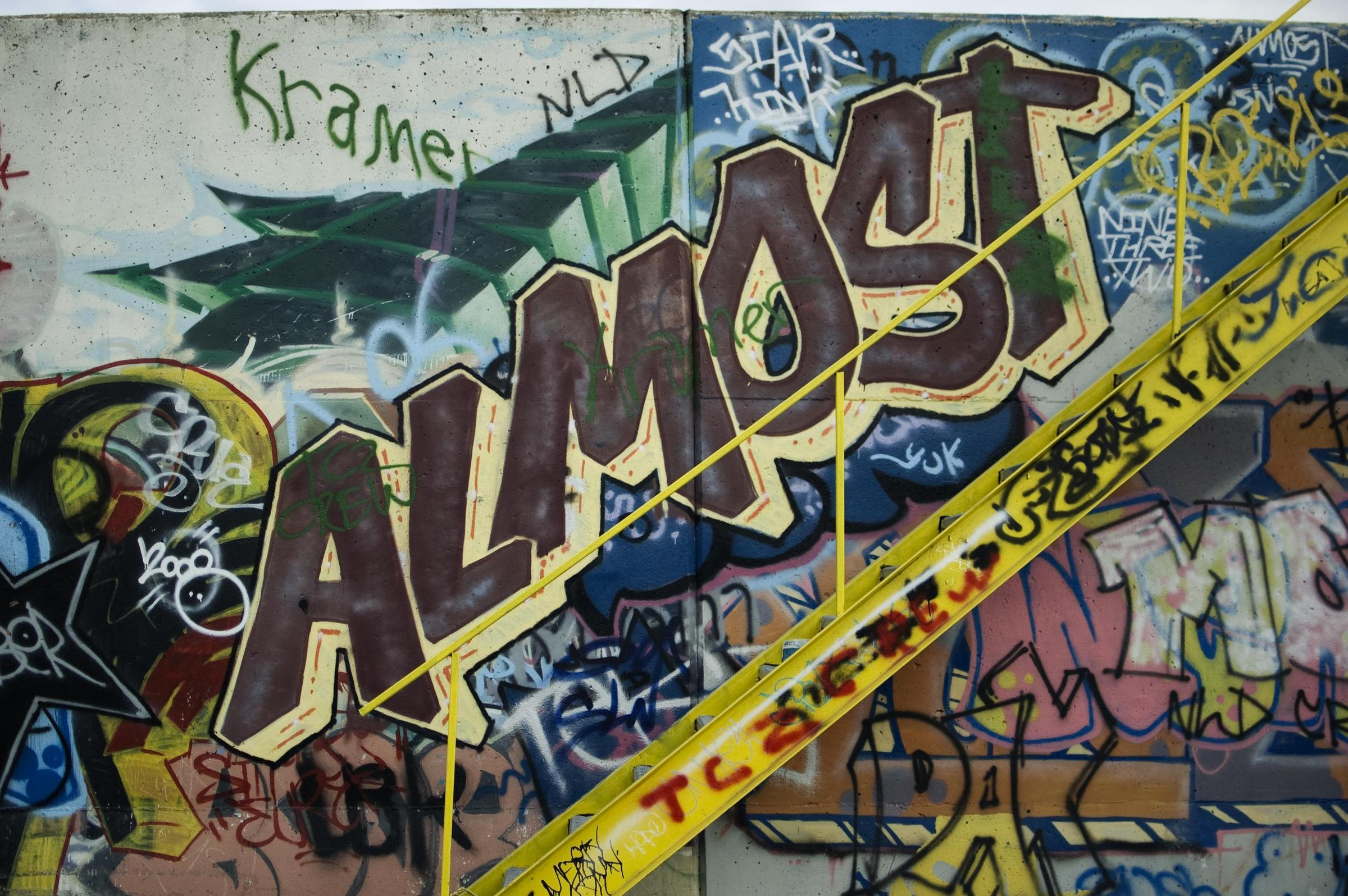 is graffiti art? and what is the difference between murals and legal