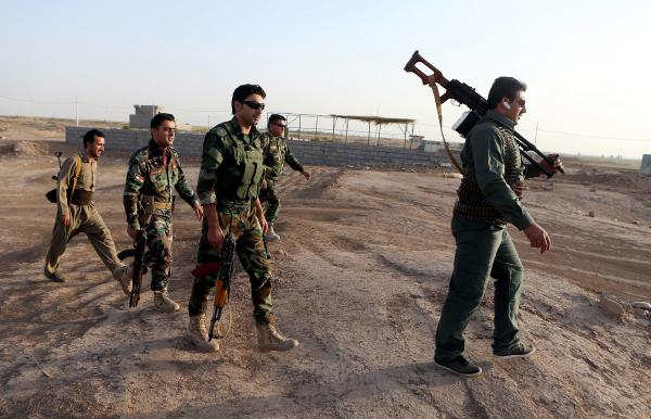 Iraqi Kurdish peshmerga fighters take up positions around the town of Gwer in northern Iraq on Sept. 18. The Kurdish militia is aligned with the U.S. in the battle against the Islamic State.