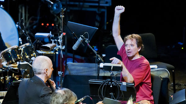 John Zorn, in red, conducts music from 'Book of Angels' with the Bar Kokhba Sextet (feat. Marc Ribot on guitar, Mark Feldman on violin, Erik Friedlander on cello, and Cyro Baptista on percussion) during his 'Masada Marathon' at Lincoln Center in New York on March 30, 2011.
