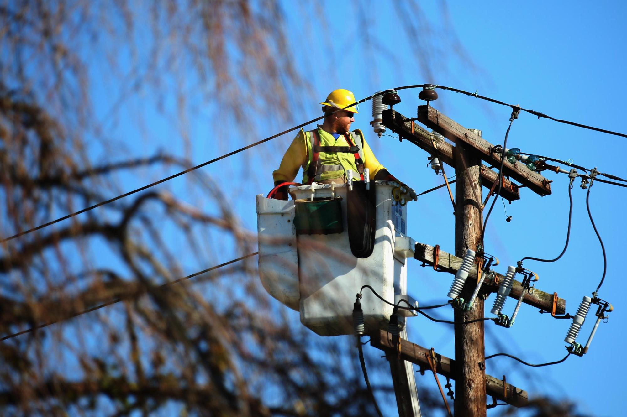 hight resolution of a worker repairs electrical lines in plainview n y after superstorm sandy in 2012