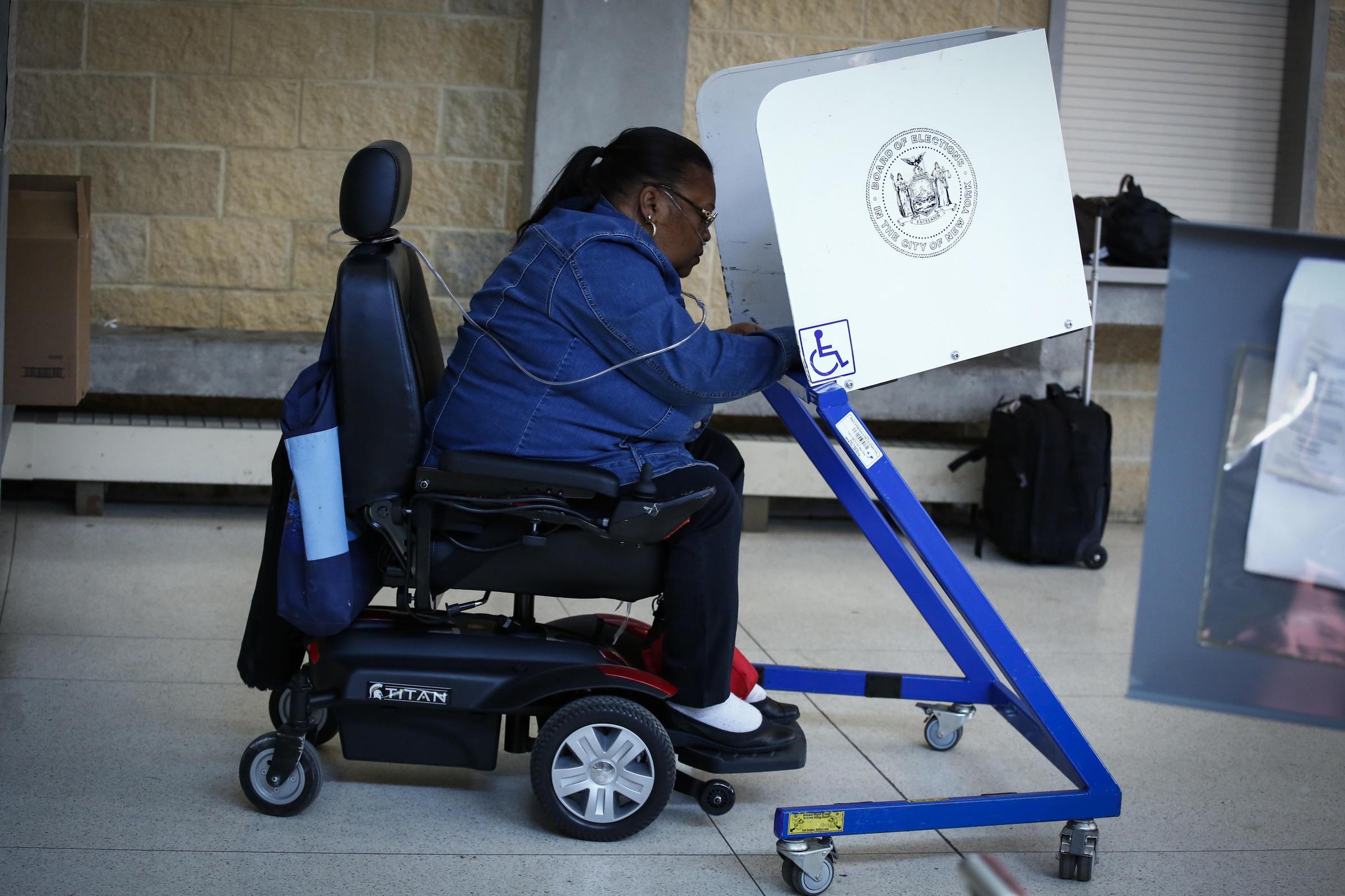 wheelchair fight camping rocking chairs voters with disabilities for more accessible polling places wfae a woman casts her vote at station in brooklyn the new york state presidential primary on april 19